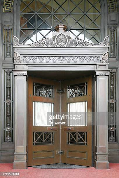revolving doors in a fancy building - art deco stock pictures, royalty-free photos & images