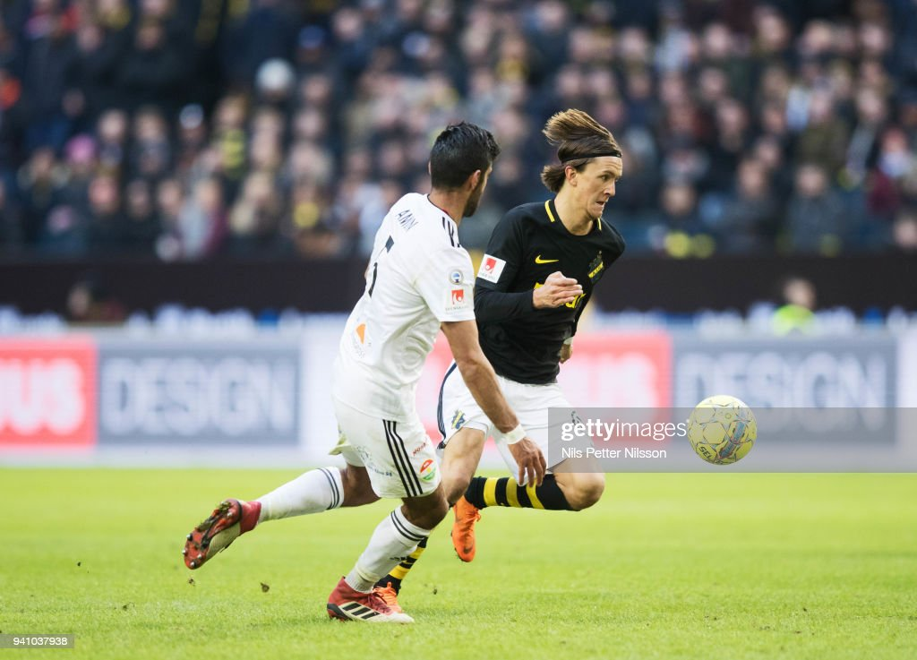 Rewan Amin of Dalkurd FF and Kristoffer Olsson of AIK competes for the ball during the Allsvenskan match between AIK and Dalkurd FF at Friends Arena on april 2, 2018 in Solna, Sweden.