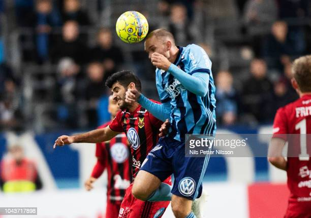 Rewan Amin of Ostersunds FK and Marcus Danielsson of Djurgardens IF competes for the ball during the Allsvenskan match between Djurgardens IF and...