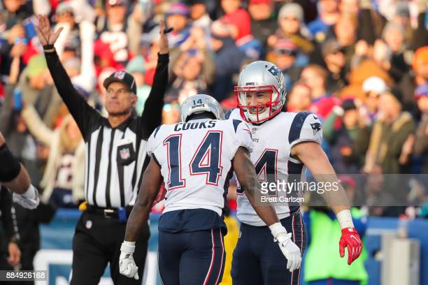 Rex Burkhead and Brandin Cooks of the New England Patriots celebrate after Burkhead scored a touchdown during the third quarter against the Buffalo...