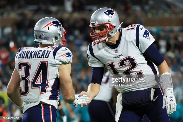 Rex Burkhead celebrates his touchdown with Tom Brady of the New England Patriots in the second quarter against the Miami Dolphins at Hard Rock...