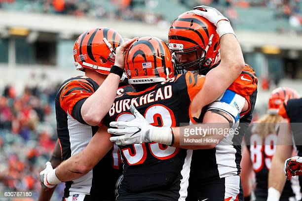 Rex Burkhead is congratulated by Andy Dalton and Jake Fisher all of the Cincinnati Bengals after scoring a touchdown during the fourth quarter of the...