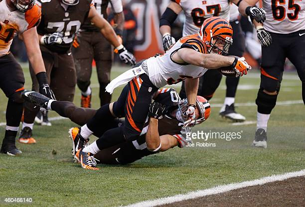 Rex Burkhead of the Cincinnati Bengals dives for a touchdown in front of Jordan Poyer of the Cleveland Browns during the fourth quarter at...