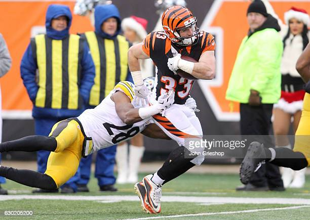 Rex Burkhead of the Cincinnati Bengals is tackled by Sean Davis of the Pittsburgh Steelers during the second quarter at Paul Brown Stadium on...