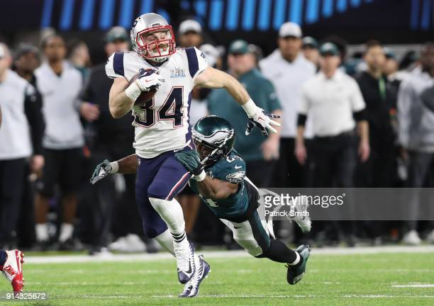 Rex Burkhead of the New England Patriots breaks a tackle from Corey Graham of the Philadelphia Eagles during the second quarter in Super Bowl LII at...