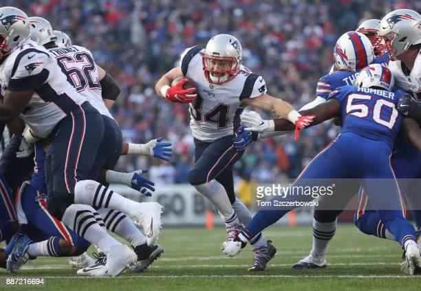Rex Burkhead of the New England Patriots carries the ball as he finds an opening during NFL game action against the Buffalo Bills at New Era Field on...