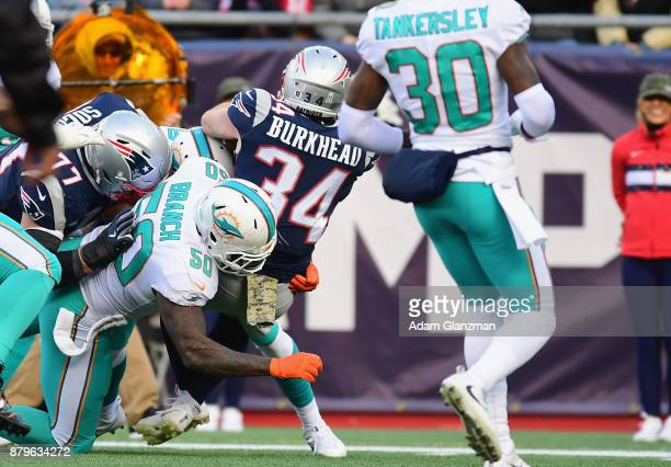 Rex Burkhead of the New England Patriots carries the ball during the second quarter of a game against the Miami Dolphins at Gillette Stadium on...