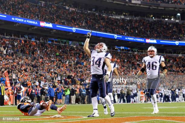 Rex Burkhead of the New England Patriots celebrates his 70 touchdown reception as Darian Stewart of the Denver Broncos lies on the grass during the...