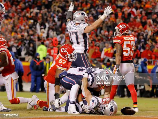 Rex Burkhead of the New England Patriots celebrates with James Develin after scoring the gamewinning touchdown to defeat the Kansas City Chiefs in...