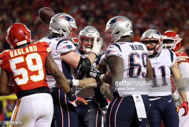 Rex Burkhead of the New England Patriots celebrates with teammates after rushing for a 4yard touchdown in the fourth quarter against the Kansas City...