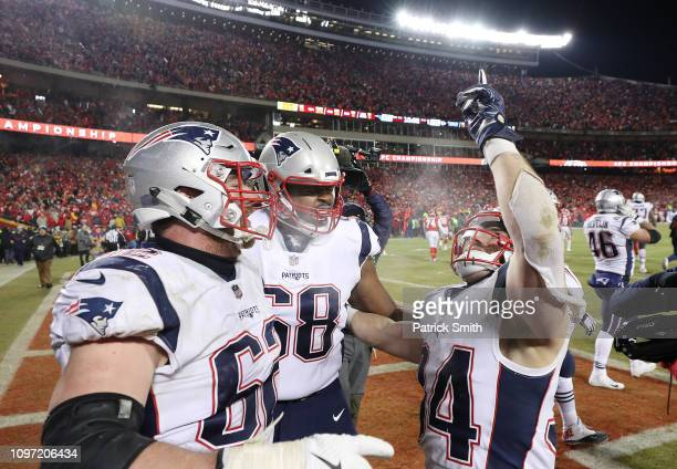 Rex Burkhead of the New England Patriots celebrates with teammates after scoring the gamewinning touchdown to defeat the Kansas City Chiefs in...