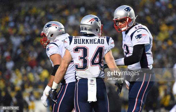 Rex Burkhead of the New England Patriots celebrates with Tom Brady after rushing for a oneyard touchdown in the first quarter during the game against...