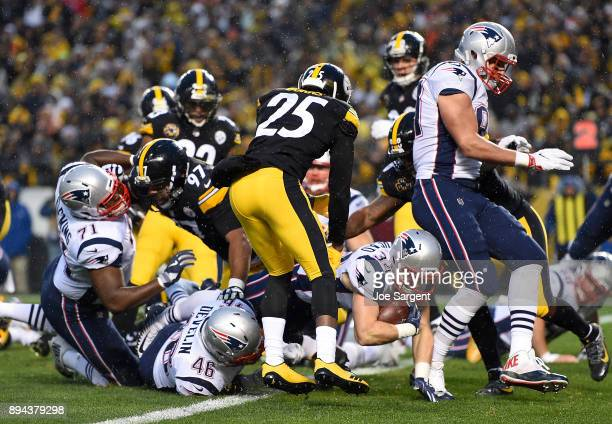 Rex Burkhead of the New England Patriots dives into the end zone for a touchdown in the first quarter during the game against the Pittsburgh Steelers...
