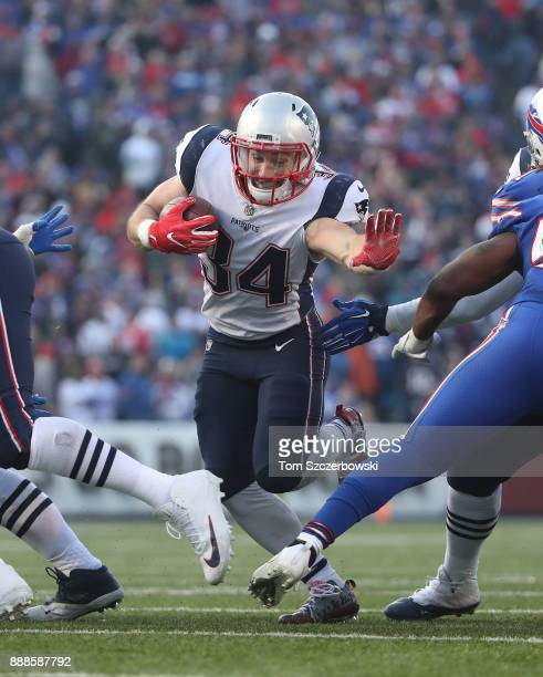 Rex Burkhead of the New England Patriots finds an opening and carries the ball through it during NFL game action against the Buffalo Bills at New Era...