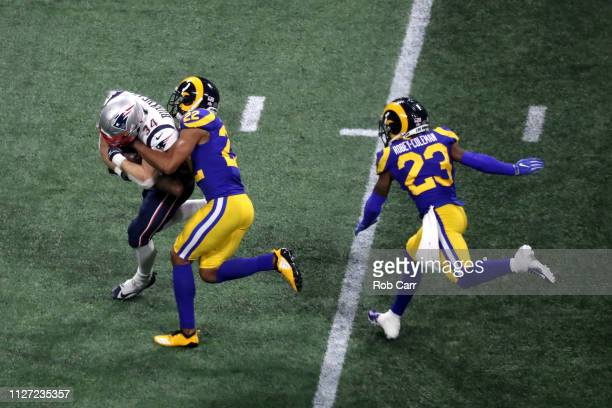 Rex Burkhead of the New England Patriots is tackled by Marcus Peters of the Los Angeles Rams in the second half during Super Bowl LIII at...