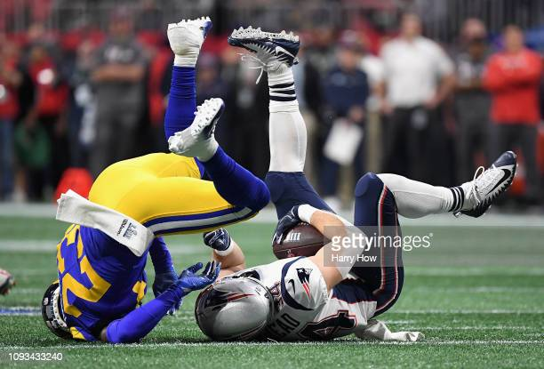 Rex Burkhead of the New England Patriots is tackled by Nickell RobeyColeman of the Los Angeles Rams during Super Bowl LIII at MercedesBenz Stadium on...