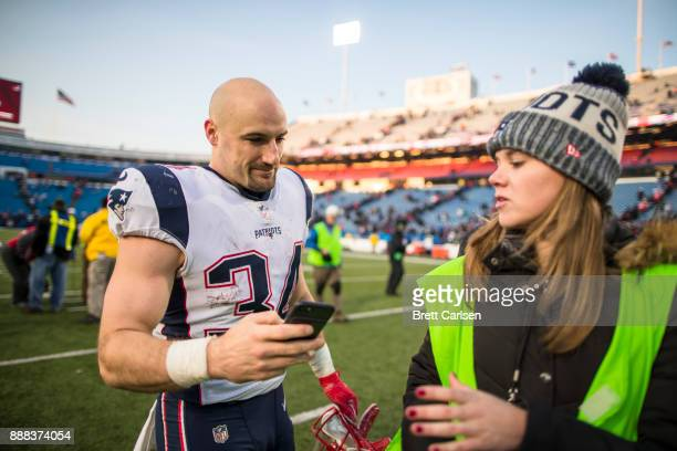 Rex Burkhead of the New England Patriots participates in a social media campaign after the game against the Buffalo Bills at New Era Field on...