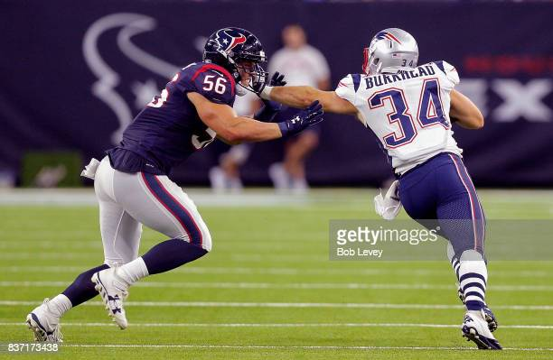 Rex Burkhead of the New England Patriots reaches out to give Brian Cushing of the Houston Texans a stiff arm in a preseason game at NRG Stadium on...