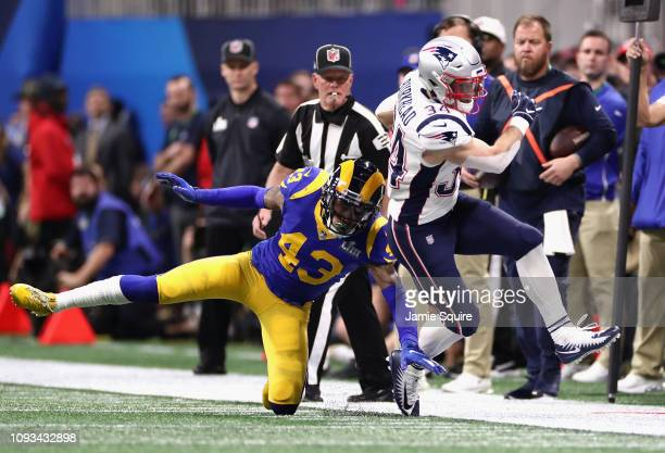 Rex Burkhead of the New England Patriots runs the ball against John Johnson III of the Los Angeles Rams in the first quarter of the Super Bowl LIII...