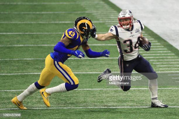 Rex Burkhead of the New England Patriots runs the ball against John Johnson III of the Los Angeles Rams in the first quarter of Super Bowl LIII at...