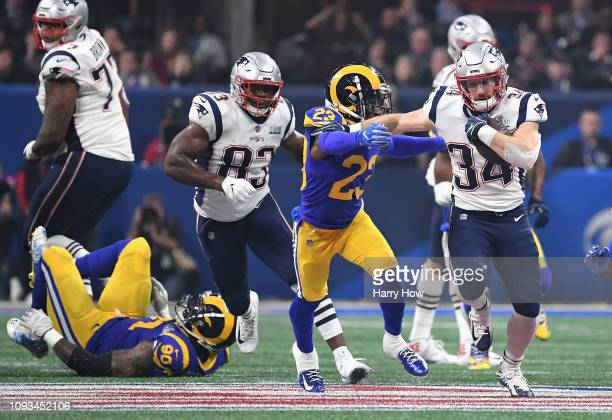Rex Burkhead of the New England Patriots runs the ball against the Los Angeles Rams in the second half during Super Bowl LIII at MercedesBenz Stadium...