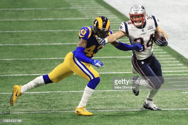 Rex Burkhead of the New England Patriots runs the ball agaisnt John Johnson III of the Los Angeles Rams in the first quarterof the Super Bowl LIII at...