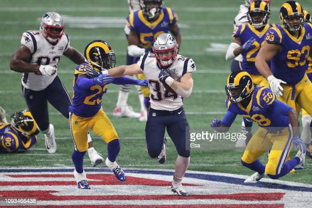 Rex Burkhead of the New England Patriots runs the ball in the second half during Super Bowl LIII against the New England Patriots at MercedesBenz...