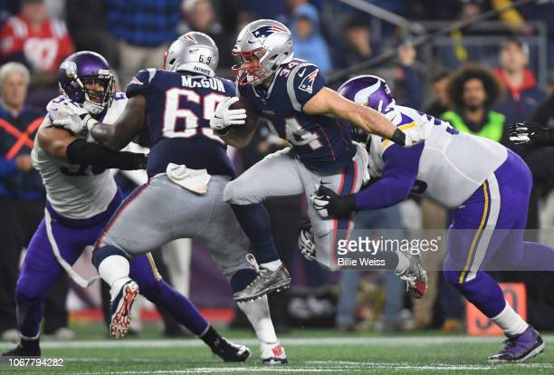 Rex Burkhead of the New England Patriots runs with the ball during the first half against the Minnesota Vikings at Gillette Stadium on December 2...