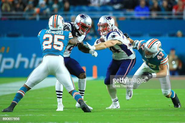 Rex Burkhead of the New England Patriots rushes during the second quarter against the New England Patriots at Hard Rock Stadium on December 11 2017...
