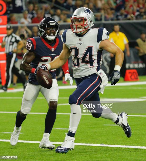 Rex Burkhead of the New England Patriots scores a touchdown in front of Andre Hal of the Houston Texans in the second quarter at NRG Stadium on...