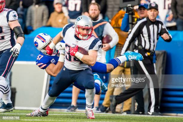Rex Burkhead of the New England Patriots sheds a tackle by Lorenzo Alexander of the Buffalo Bills while carrying the ball during the second half at...