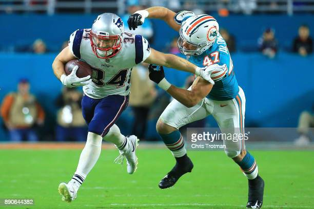 Rex Burkhead of the New England Patriots tries to avoid the tackle from Kiko Alonso of the Miami Dolphins during the second quarter at Hard Rock...