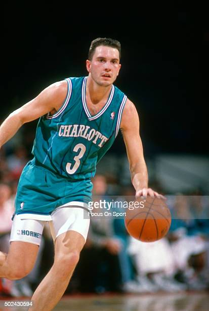 Rex Chapman of the Charlotte Hornets dribbles the ball against the Washington Bullets during an NBA basketball game circa 1991 at the Capital Centre...