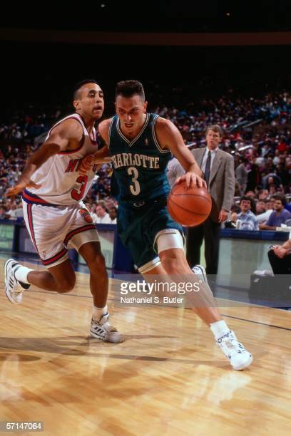 Rex Chapman of the Charlotte Hornets drives to the basket against John Starks of the New York Knicks circa 1991 at Madison Square Garden in New York...