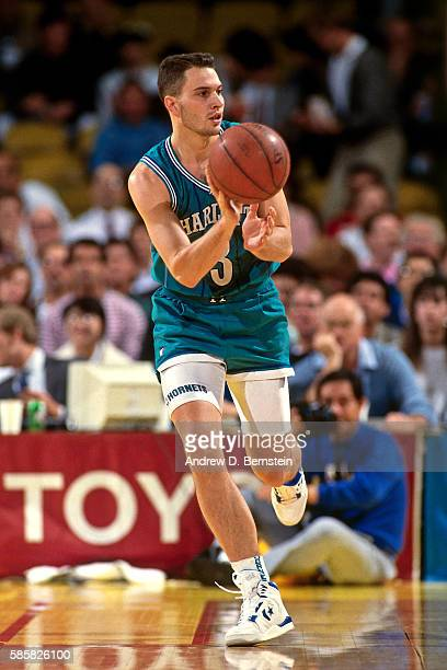 Rex Chapman of the Charlotte Hornets passes the ball during a game circa 1991 at the Charlotte Coliseum in Charlotte North Carolina NOTE TO USER User...