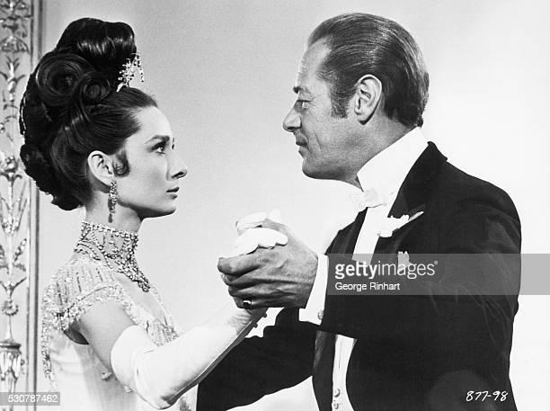 Rex Harrison as Professor Higgins and Audrey Hepburn as Eliza in the filmversion of the Alan Jay Lerhner/Frederick Lowe stagehit My Fair Lady...