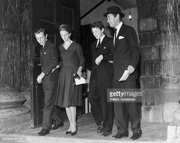 Rex Harrison attending a memorial service for his late wife actress Kay Kendall at St Martinsinthefields London He is with his sons Noel and Carey...