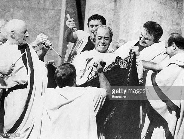 Rex Harrison playing Julius Caesar is stabbed to death in the Roman Senate in the historical epic film Cleopatra