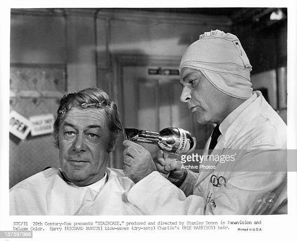 Rex Harrison's hair is blow dried by Richard Burton in a scene from the film 'Staircase' 1969