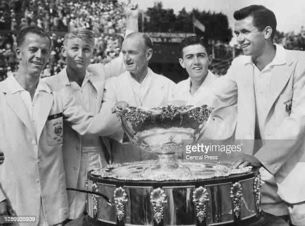 Rex Hartwig, Lew Hoad, team captain Harry Hopman, Ken Rosewall and Mervyn Rose celebrate after being presented with the Davis Cup after defeating the...