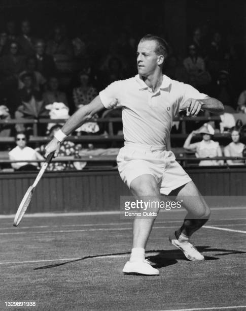 Rex Hartwig of Australia reaches to play a back hand return to Edwin Tsai of Hong Kong during their Men's Singles Second Round match at the Wimbledon...