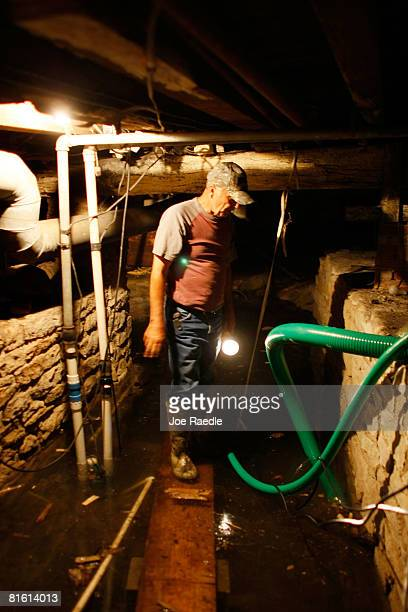 Rex Hipes checks on the sump pump in the basement of the Clarksville Christian church they fight to keep the flooding Mississippi River from...