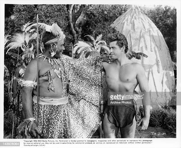 Rex Ingram and Gordon Scott make the sign of friendship in a scene from the film 'Tarzan's Hidden Jungle', 1955.