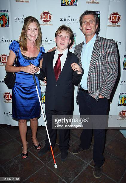 Rex LewisClack Anthony Shriver and guest arrive at the reception celebrating the Best Buddies Challenge Hearst Castle at the Tehama Golf Club on...
