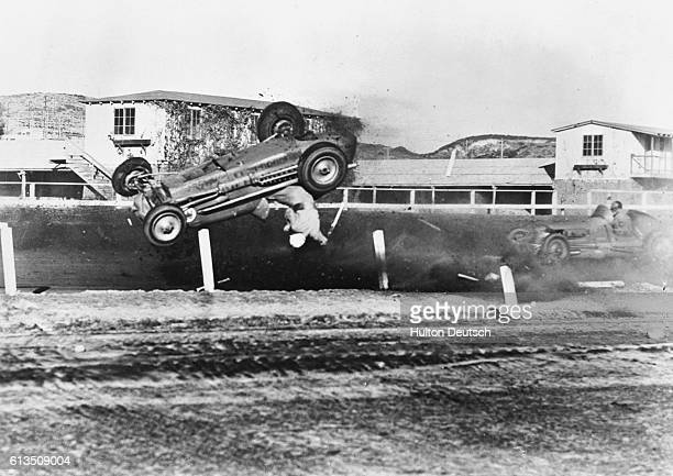 Rex Mays and his racecar fly through the air upsidedown as his vehicle crashes killing him during a race in Del Mar California