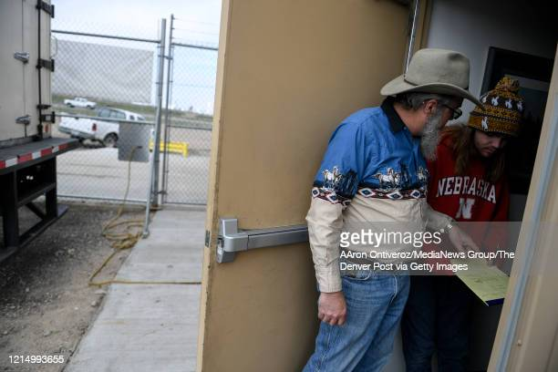Rex Moore owner of Rock River Ranches talks to his son Ethan after a pickup of fresh meats on Thursday March 26 2020 Moore said that his business was...