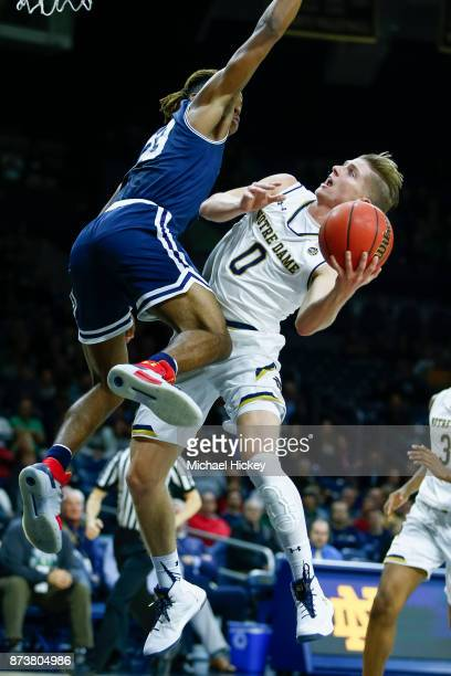 Rex Pflueger of the Notre Dame Fighting Iris shoots the ball against Greg Alexander of the Mount St Mary's Mountaineers at Purcell Pavilion on...