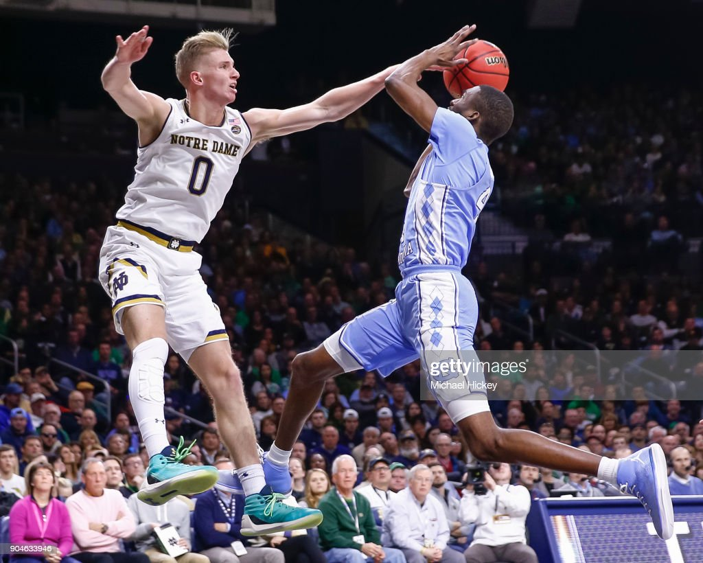Rex Pflueger #0 of the Notre Dame Fighting Irish defends as Brandon Robinson #4 of the North Carolina Tar Heels goes up for the shot at Purcell Pavilion on January 13, 2018 in South Bend, Indiana.