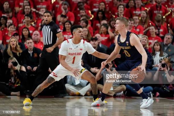 Rex Pflueger of the Notre Dame Fighting Irish dribbles the ball as Anthony Cowan Jr #1 of the Maryland Terrapins defends in the second half at...