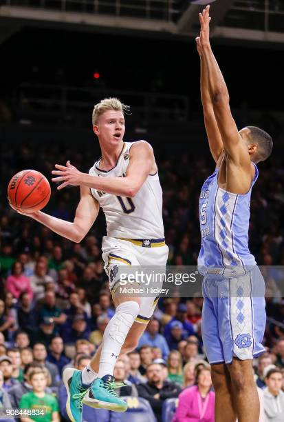 Rex Pflueger of the Notre Dame Fighting Irish passes the ball off during the game against Garrison Brooks of the North Carolina Tar Heels at Purcell...